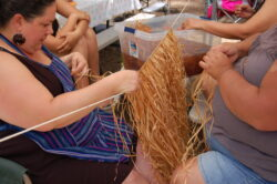 Holly Hensher, Pimm Tripp-Allen and Tyithreeha Allen making a maple bark skirt which is used by women in all ceremonies and traditionally in everyday life. Photo courtesy the artist.